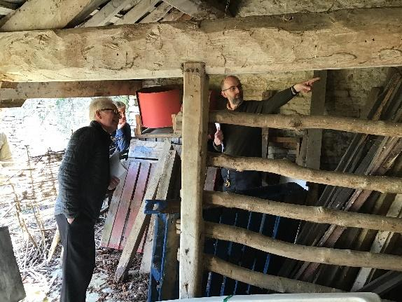 Men looking at timbers in building